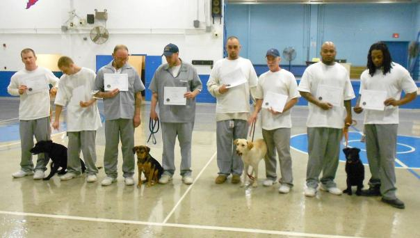 Puppies for Parole graduates and their offender handlers in Moberly, Missouri.