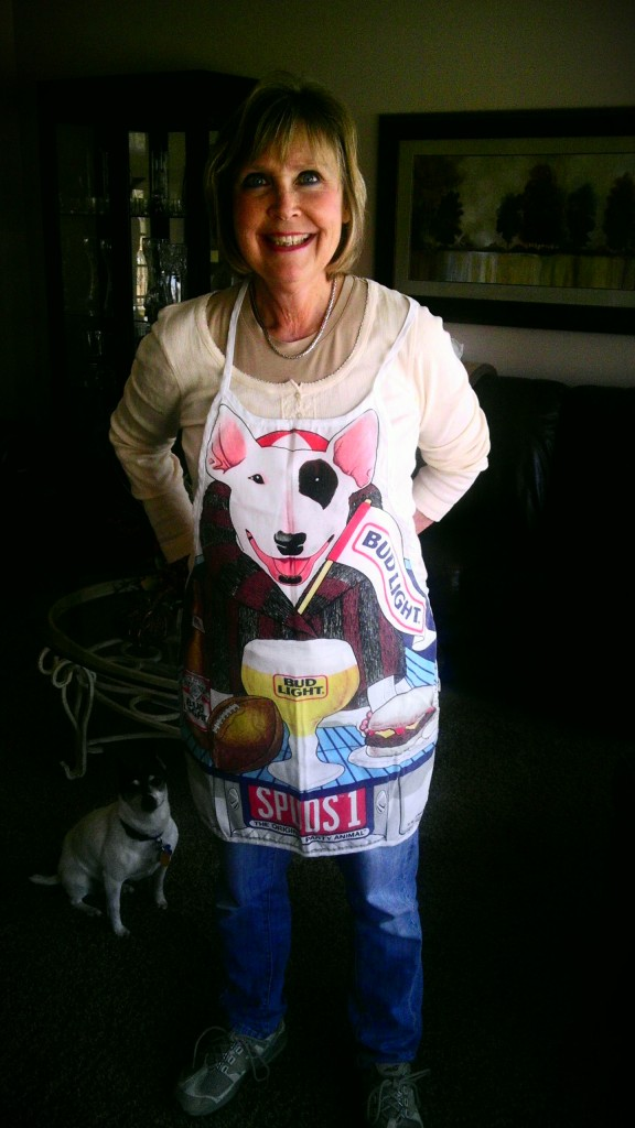 mom wearing a spuds mackenzie apron